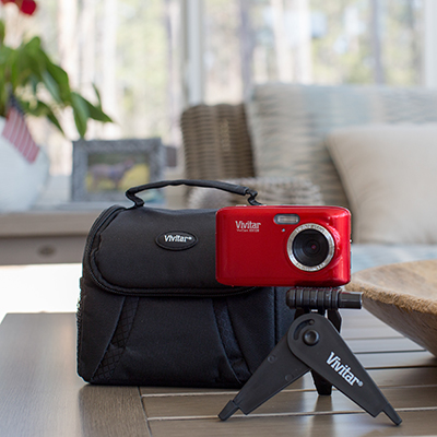 "VIVITAR<sup>&reg;</sup> Vivicam 20.1MP Camera Kit - Capture every detail in your next picture with this vibrant red Vivitar<sup>&reg;</sup> camera featuring 20.1 mega pixels and 4x digital zoom.  Includes Vivitar<sup>&reg;</sup> Experience™ software, high definition, anti-shake, red-eye detection and a 2.7"" preview screen.  Also contains soft shell gadget bag, tripod and 8GB SDHC card."