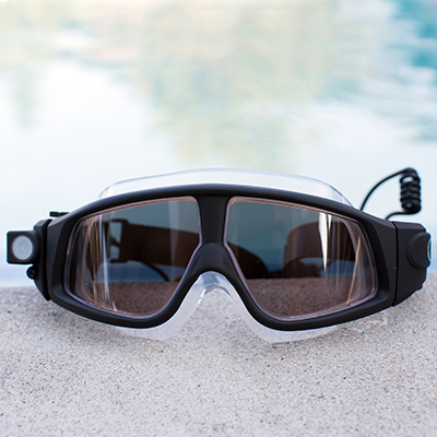 COLEMAN<sup>&reg;</sup> VisionHD Swimming Eyewear - Capture hands-free 1080p video recording and 5MP stills with this swimming eyewear.  In addition to being waterproof up to 33ft, this eyewear is also freeze-proof and dust-proof with double coated anti-fog, anti-scratch, anti-shock UV protections lenses.  Includes built-in lithium-ion battery, USB cable and AC adaptor.  1080 full HD 30fps and 720p HD 60fps.  135° super wide angle lens.