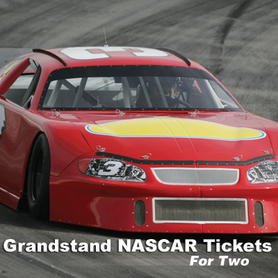 Grandstand NASCAR<sup>®</sup> Tickets - Imagine you and a friend at one of NASCAR's exciting races.  It's the ultimate racing fan experience!  Includes 2 grandstand tickets. Race to be determined based on scheduling. Airfare not included.