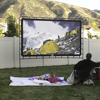 CAMP CHEF<sup>®</sup> O.E.G.™ Outdoor Big Screen - Made of oxford nylon reflective material, this outdoor screen offers 12 feet of viewing pleasure.  Durable free-standing frame also features four tie-down guy lines for increased stability.  Back cover blocks ambient light and can be rolled up for rear projection.  Wide screen 16:9 aspect ratio.  Carry bag included.